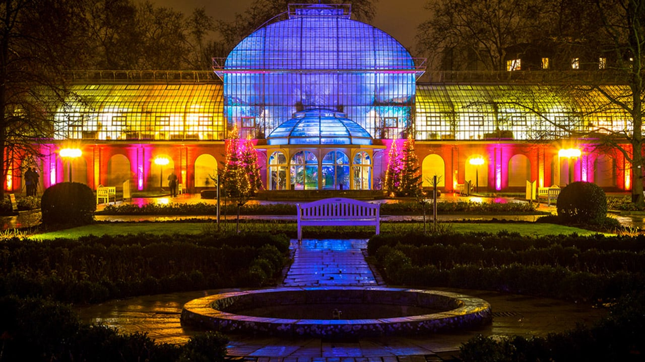 The Palmengarten, Frankfurt lit up at night. A view of the Botanical gardens