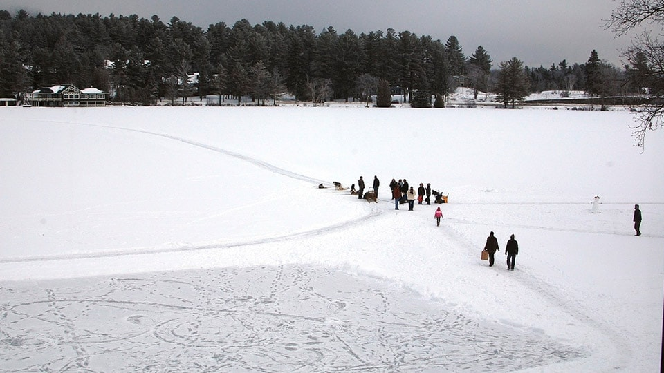 Lake Placid in New York frozen with people sledging across