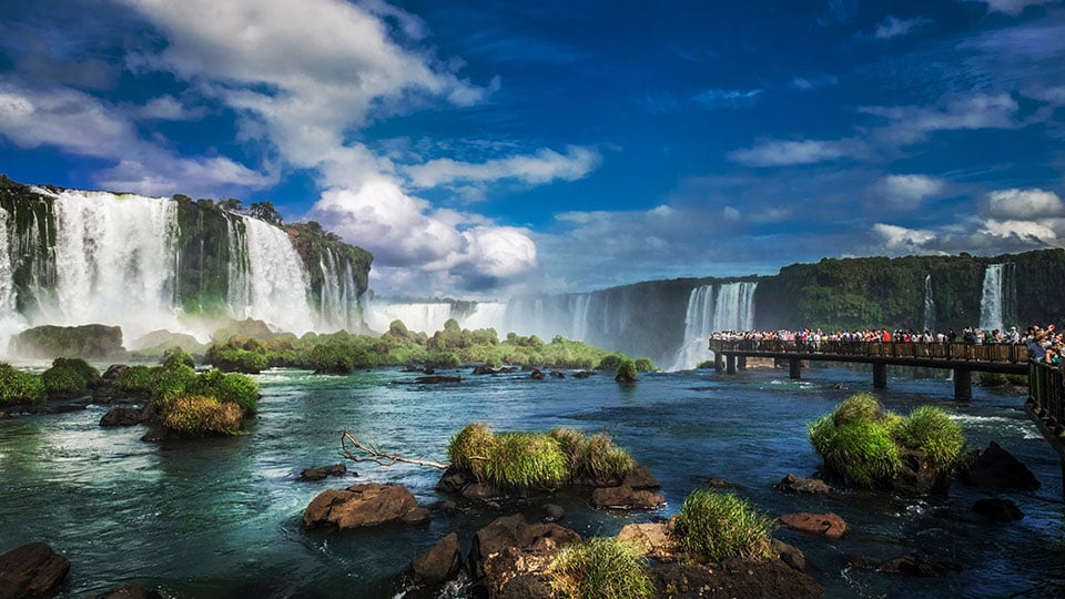Tourists at Iguazu Falls, one of the world's great natural wonders, near the border of Argentina and Brazil.
