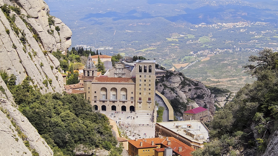 Santa Maria de Montserrat Abbey in Monistrol de Montserrat, Catalonia, Spain. Famous for the Virgin of Montserrat